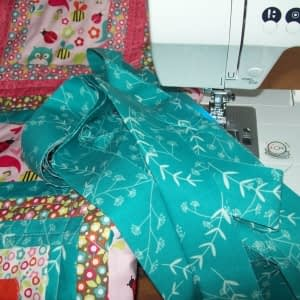 Step 7: the double binding is sewn on by machine. I use a 3 1/2 inch binding doubled over for strength.